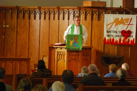 Pastor Gary Schultz delivers a sermon from the pulpit at Trinity Lutheran on Stewart in Wausau, WI.