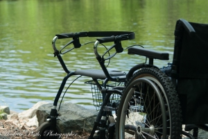 The wheel chairs symbolize limitations.  But on the water, there are no limitations.